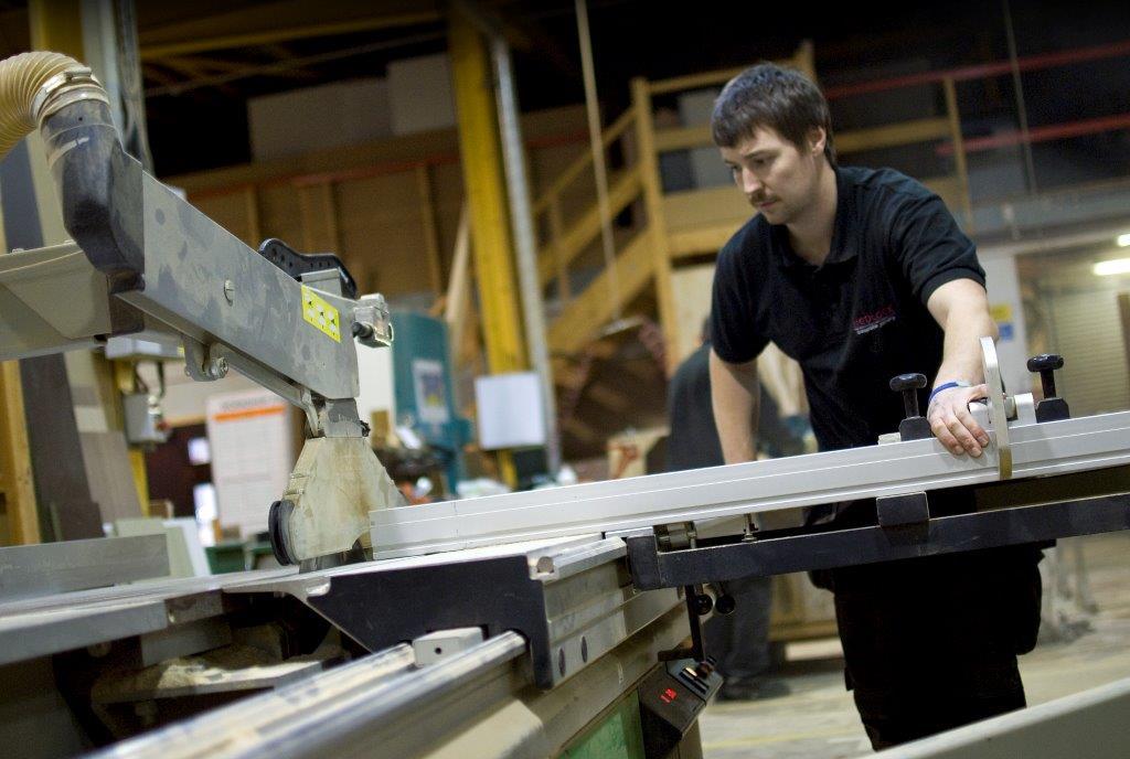 Bench hand Chris Jones at work in Medlock FRB's bespoke joinery workshop