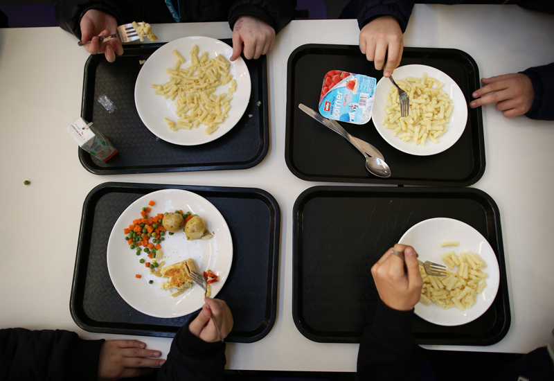 LONDON, ENGLAND - DECEMBER 01: Students eat their lunch in the canteen at a secondary school on December 1, 2014 in London, England. Education funding is expected to be an issue in the general election in 2015. (Photo by Peter Macdiarmid/Getty Images)