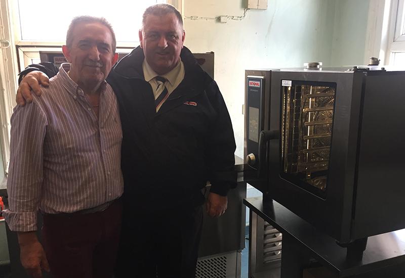 Alan Curtis, regional development chef at Rational, presents a Rational combi oven to Francesco Obinu, owner of Sardis Restaurant, Darlington