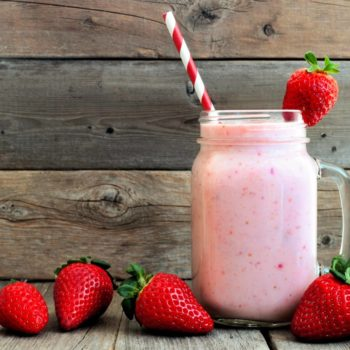 Strawberry smoothie with paper straw