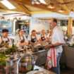 Colten Care chefs at The Kitchen at Chewton Glen cookery school with tutor chef Steve Bulmer