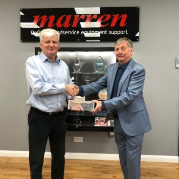 John McLeary, head of building maintenance at Mitchells & Butlers presents contractor of the year award 2019 to Bob Clifford, managing director, Marren Group