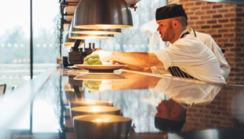 Chef in open kitchen