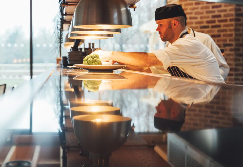 Chef in open kitchen