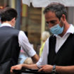 Cafe waiter in mask