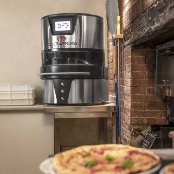 OperaPrima pizza stretcher on counter