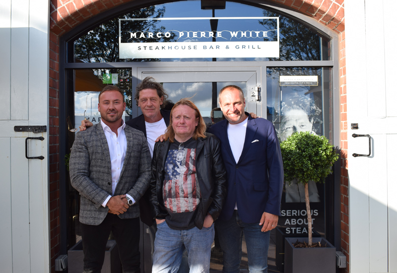 Marco Pierre White with the Black and White hospitality team